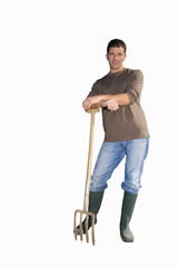 man in wellington boots leaning on garden fork, cut out