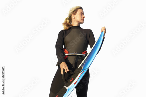 woman in wetsuit holding surfboard, cut out