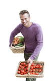 man holding baskets of vegetables, cut out