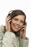 young woman listening to earphones, cut out