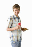 young man holding plate of food and glass of juice, cut out