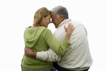 senior couple, view from behind, hugging, cut out