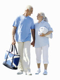 senior couple walking together with beach towel, cut out