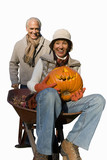 senior couple in autumn with wheelbarrow and pumpkin, cut out
