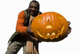 senior man holding large pumpkin, cut out