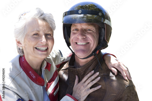 senior couple wearing motorcycle helmet, cut out