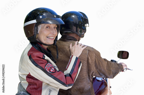 senior couple on motorcycle, cut out