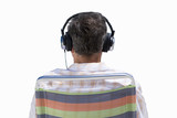 back of senior man's head wearing earphones, cut out