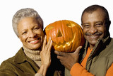 senior couple holding craved pumpkin, cut out