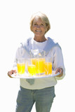 senior woman holding tray of drinks, cut out