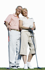 senior couple together holding golf clubs, cut out