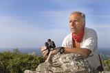 Explorer with is binoculars looking for adventure poster