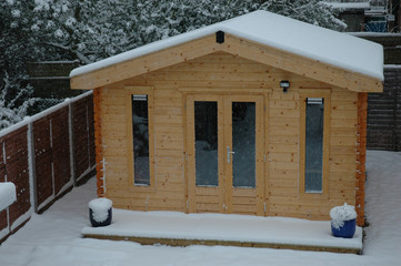 Office shed in back garden with snow