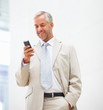Senior business man messaging using a mobile phone