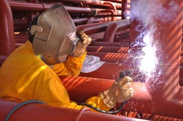 welder on chemical ship
