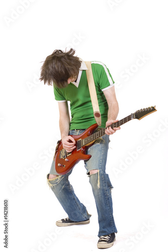 headbanging guitarist playing his guitar