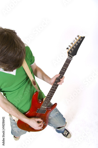 wide angle shot of a guitarist playing his electric guitar
