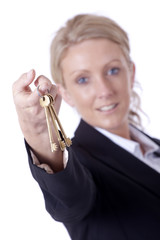 Businesswoman offering keys