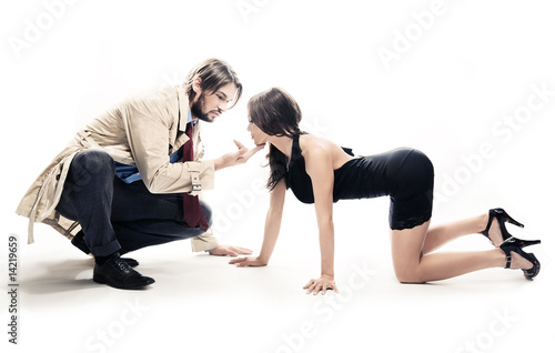 An attractive man and woman in frivolous pose, isolated on white