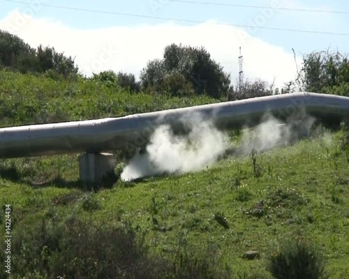 Close up showing steaming leak in overland pipe