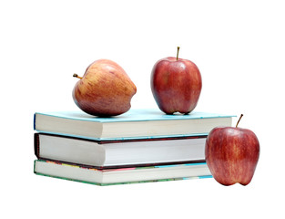 Books and three red apples isolated on white background