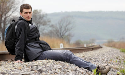 Traveler sitting on the railroad mound during the rest