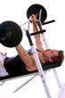 Man lying on bench and doing weightlifting