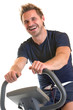 Man sitting on spinning bicycle