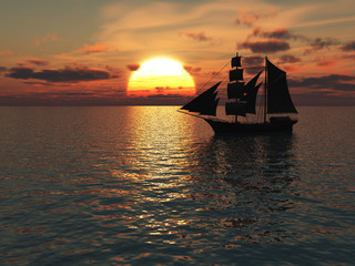 Ship out at sea at sunset.