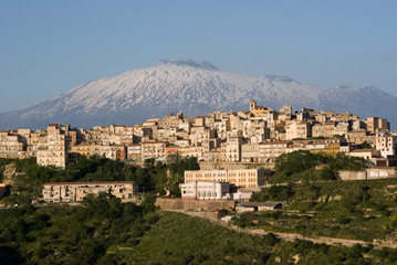 view of village and belltower on background Etna