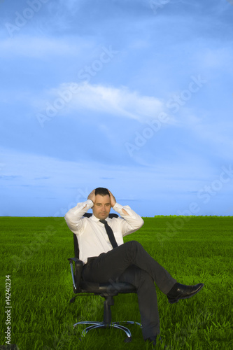 Depress young businessman sitting in the chair