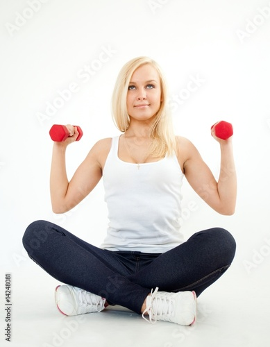 Attractive young woman with dumbbells