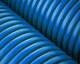 Blue plastic pipes poster