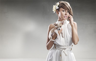 fashion photo of beautiful woman in white with the doggy