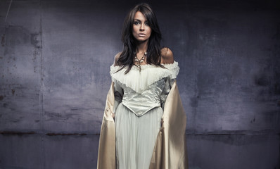 lovely woman in the beautiful dress, dark room