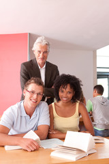 Portrait of happy students with lecturer