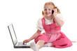 Child working on computer and having telephone call