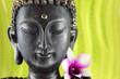 Bouddha zen et fleur d'orchidée