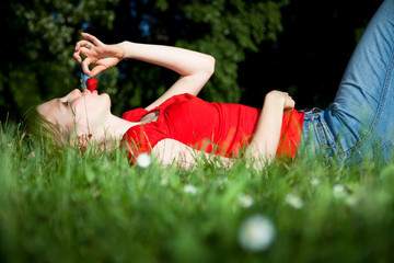 girl with strawberry in the meadow