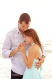young couple having close intimate conversation poster