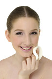 Close-up face of beauty young woman applying face foundation poster