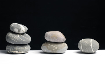 Stack stones on black background