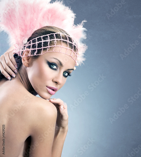 Glamour style photo of a young brunette