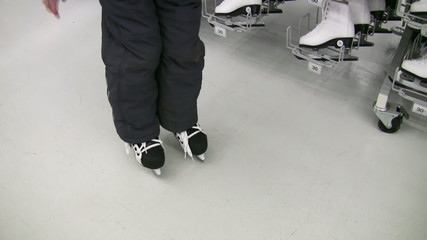 child legs with skates in shop