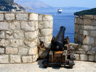 Old cannon and cruise ship in Dubrovnik old town, Croatia.