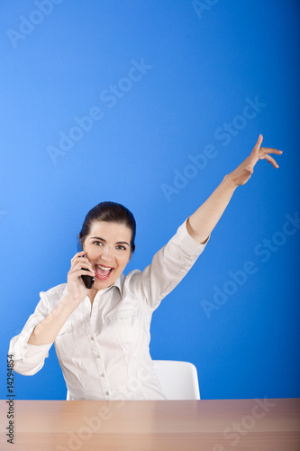 Happy woman calling at phone