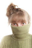 Young woman hinding face behind collar of her sweater poster