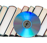 Row of books  and DVD disk as symbols of old and new methods of poster