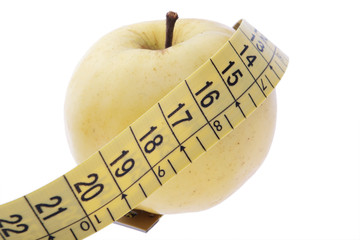 yellow apple and measuring tape