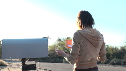 Woman gets mail side view- HD